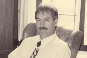 Jim Murphy sitting at his desk.