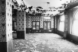 Graham Plaza's interior prior to the renovation – paint pealing off the ceiling, pigeon manure everywhere, striped wallpaper, bunched up carpet, and more.