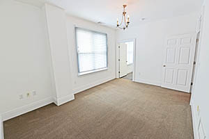 The Kirkwood, Uptown Senate, master bedroom leads into the master bathroom.