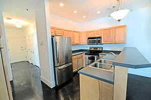 The Kirkwood, Uptown Senate, kitchen comes with stainless steal appliances.
