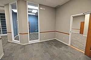 One City Centre, Suite 208, provides a reception area.