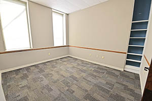 One City Centre, Suite 208, office four of five offers lots of natural light and a built-in book shelf.