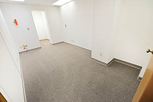 Spacious elongated suite with a storage room.