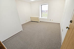 Spacious elongated suite with a window.