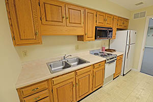 Madison & Morton, Suite 105, Kitchen provides a number of cabinets, sink, small-top stove, and refrigerator.