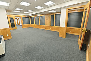 Fountain Square, Suite 232, spacious private office with multiple windows.